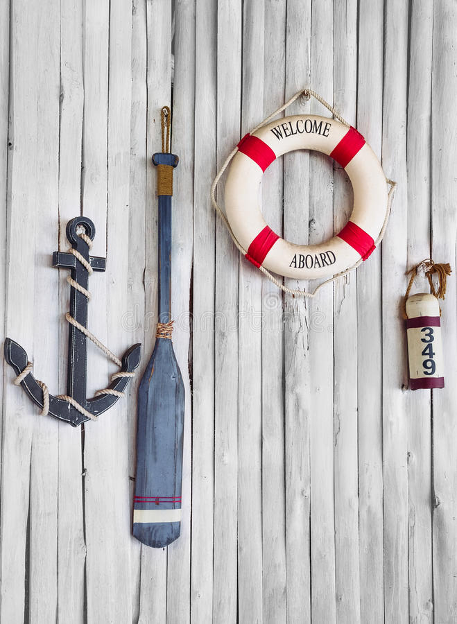 Composition on the marine theme. With anchor, paddle and lifeline on old wooden background royalty free stock photo