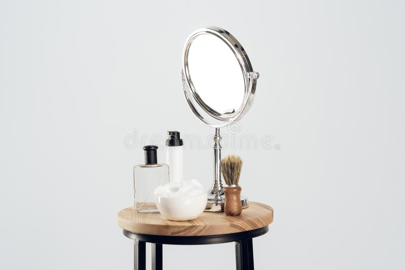 Composition of mirror and shaving set. Still life. stock photo