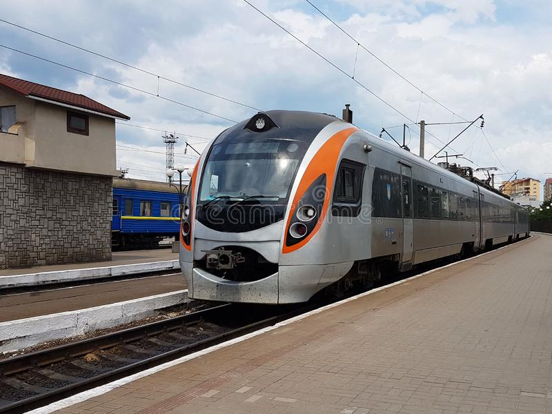 The composition of the modern train on the platform of the Lviv railway station. Infrastructure fast transport. High-tech. Mechanism for the transport of stock photo
