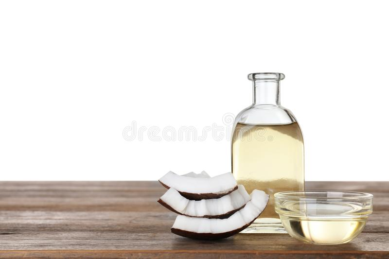 Composition with natural organic  oil on wooden table against white background. Space for text stock photo
