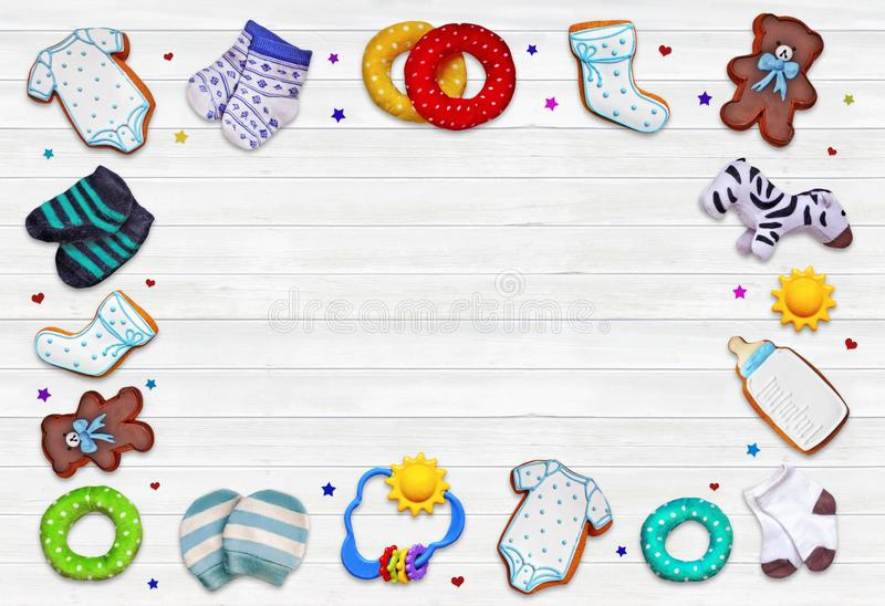 A composition for newborns on wooden white background stock images
