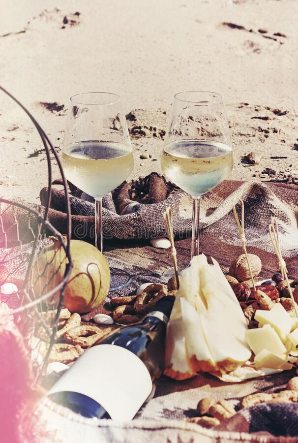 Free Composition Of White Wine, Fruit And Nuts On Sandy Beach Near The Sea Royalty Free Stock Images - 181659869
