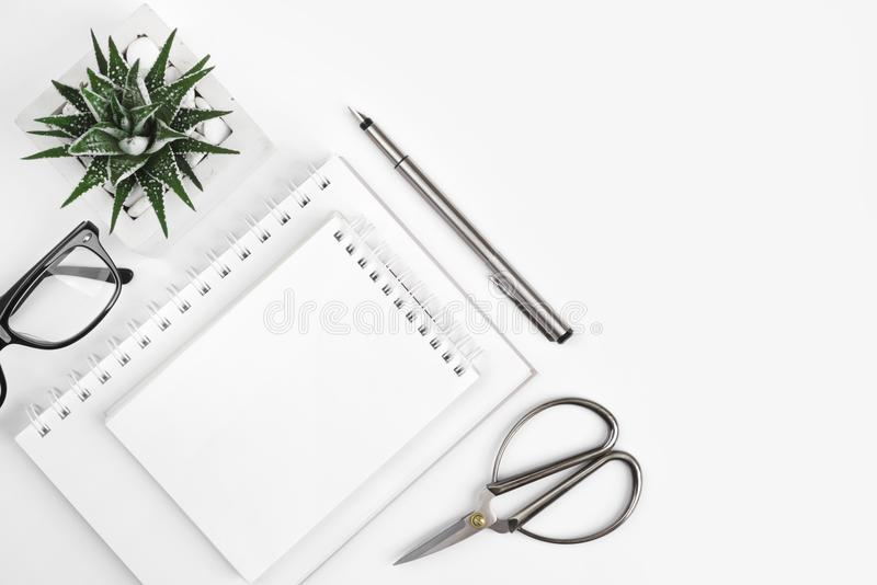 Composition of office supplies on white background with copy space stock photo