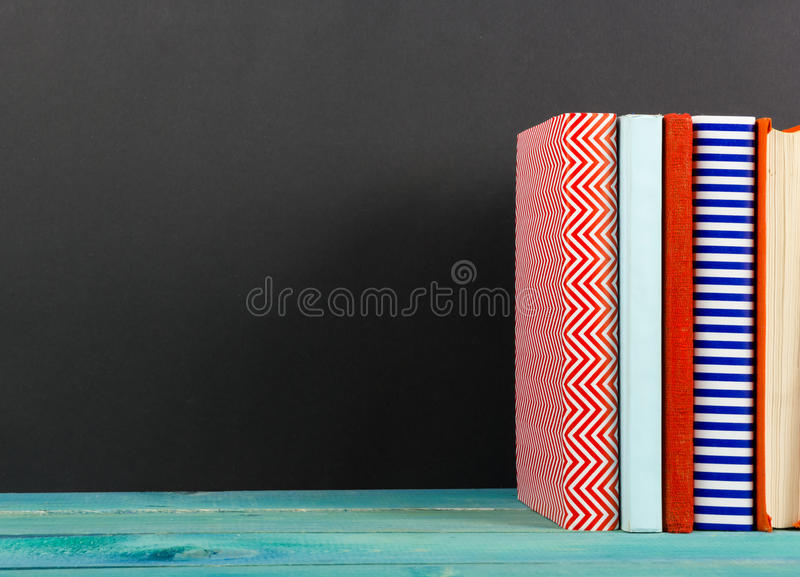 Composition with old vintage colorful hardback books, diary on w royalty free stock photography