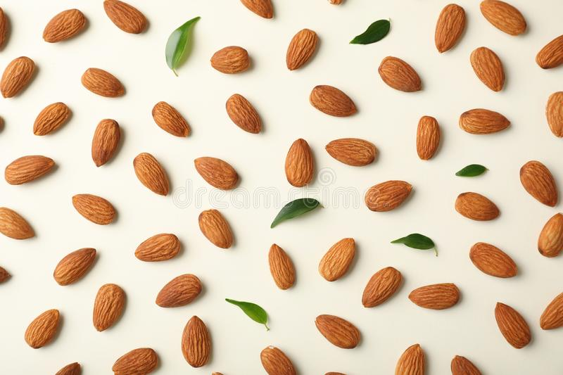 Composition with organic almond nuts on light background stock photography