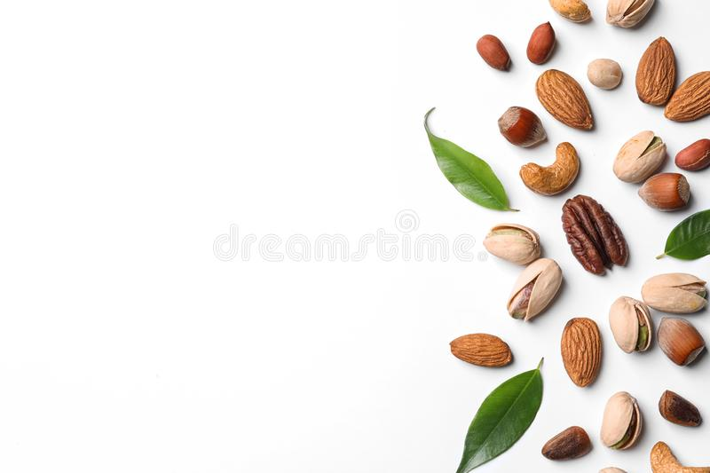 Composition with organic mixed nuts on white, top view royalty free stock photos