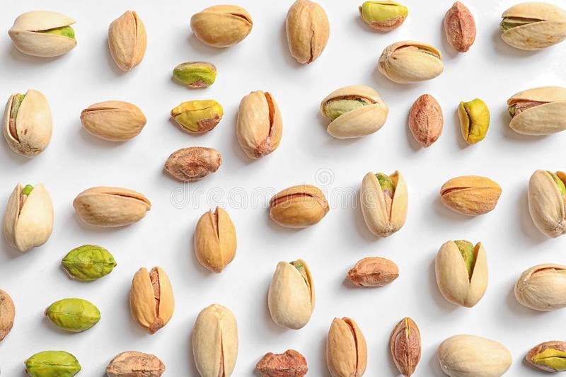 Composition with organic pistachio nuts on white, top view. Composition with organic pistachio nuts on white background, top view stock photos