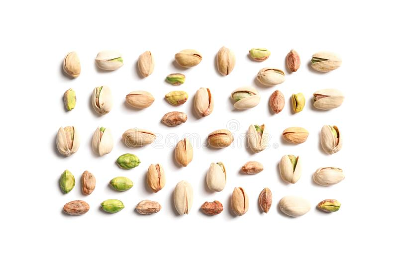 Composition with organic pistachio nuts on white, top view. Composition with organic pistachio nuts on white background, top view stock photography