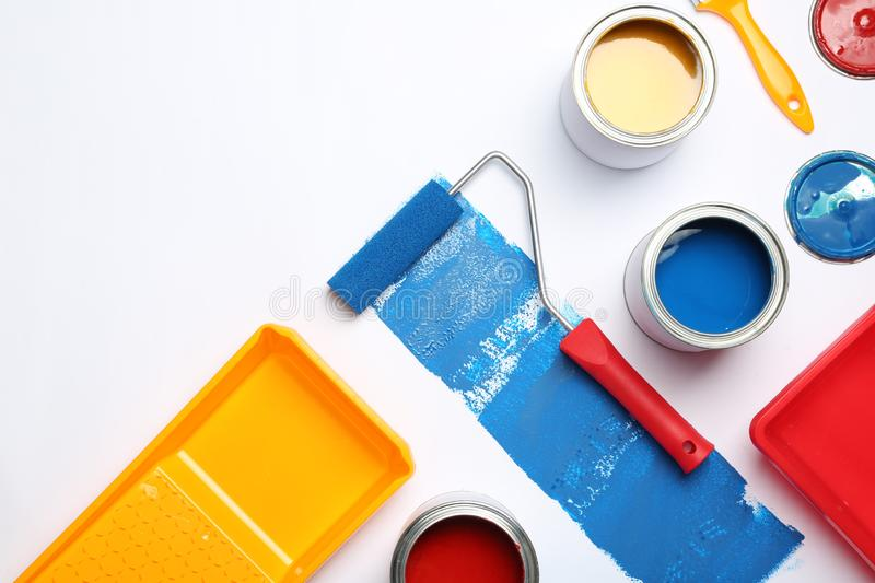 Composition with paint cans and space for text on white stock photography