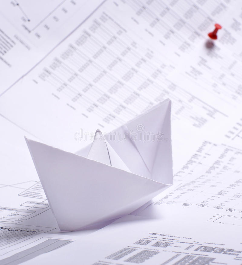 Download A Composition Of A Paper Boat And Documents Stock Photo - Image: 15721446