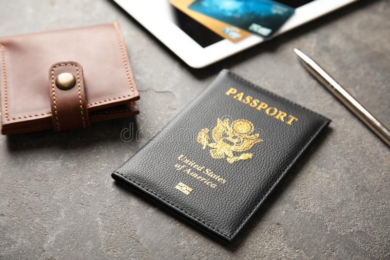 Composition with passport and wallet on table. Travel agency. Composition with passport and wallet on grey table. Travel agency stock image