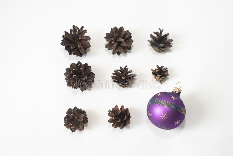 Composition of pine cones with Christmas ball isolated on white background. Holiday new year concept. Mock-up, greeting card, stock photo
