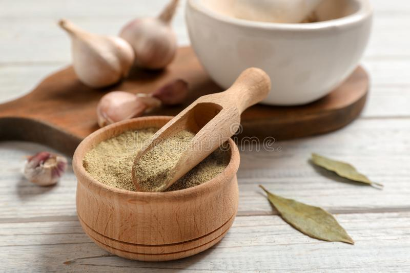 Composition with powdered pepper in scoop and bowl royalty free stock photos