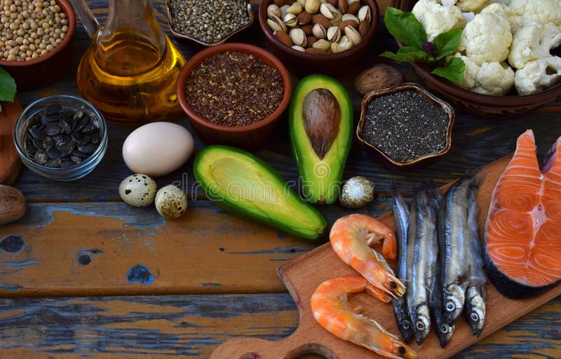 Composition of products containing unsaturated fatty acids Omega 3 - fish, nuts, avocado, eggs, soybeans, flax, pumpkin seeds, chi. A, hemp, cauliflower, dill royalty free stock image