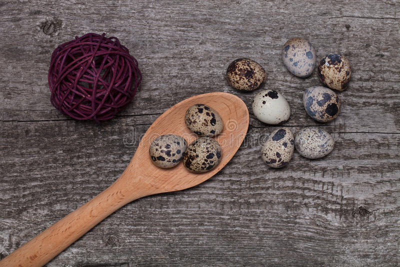 Composition with quail eggs. Wooden texture for background.  stock image