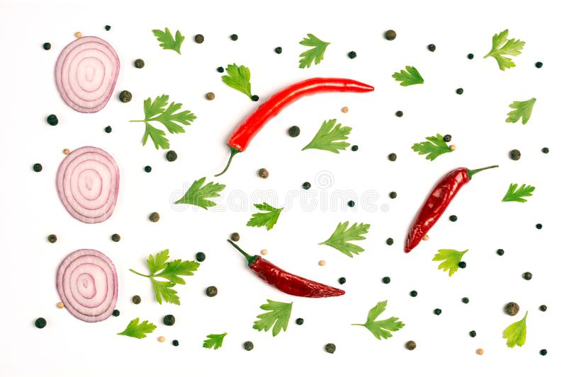 Composition of red onion, chili peppers, parsley and spices on white background. royalty free stock photos