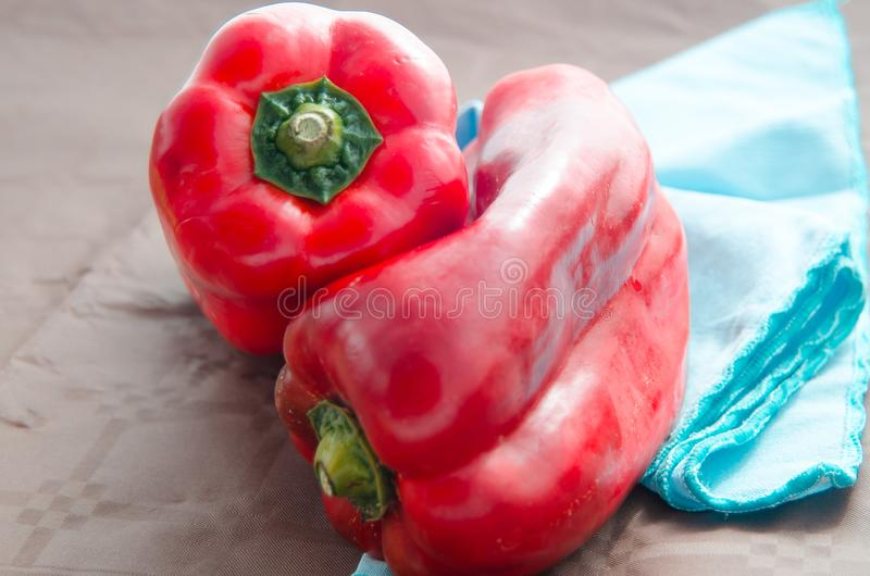 Red peppers, on table with brown tablecloth stock photo