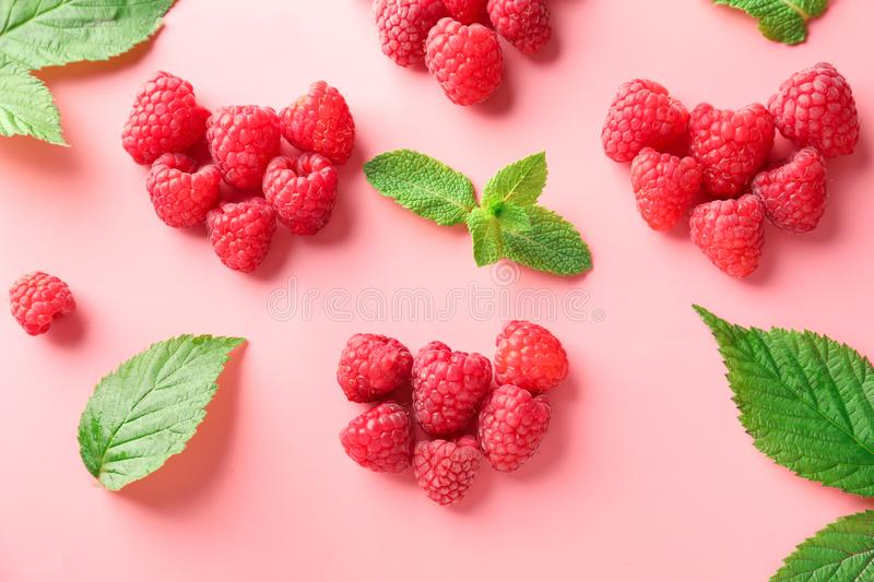 Composition with ripe aromatic raspberries on color background stock photo
