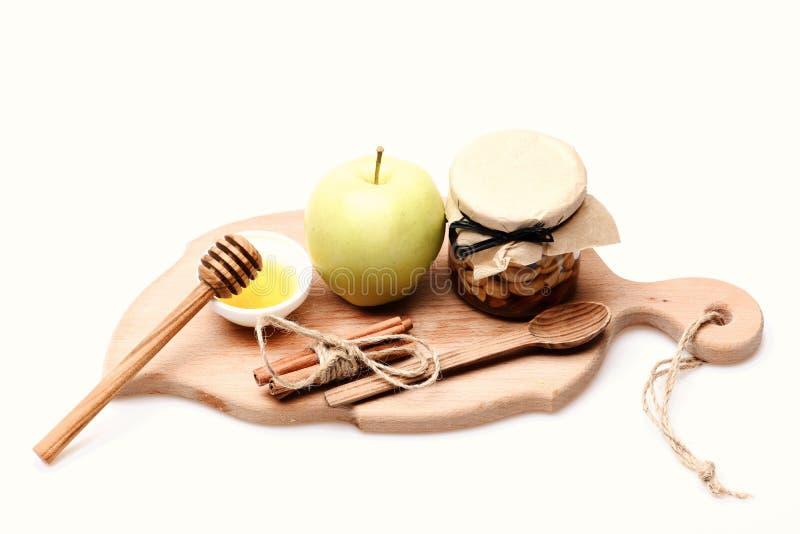 Composition rustique en cuisine Pommes, écrous et miel d'isolement sur le blanc photo stock