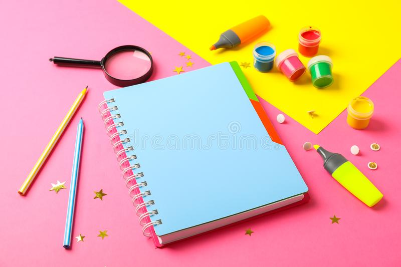 Composition with school supplies on two tone background. Space for text royalty free stock photo