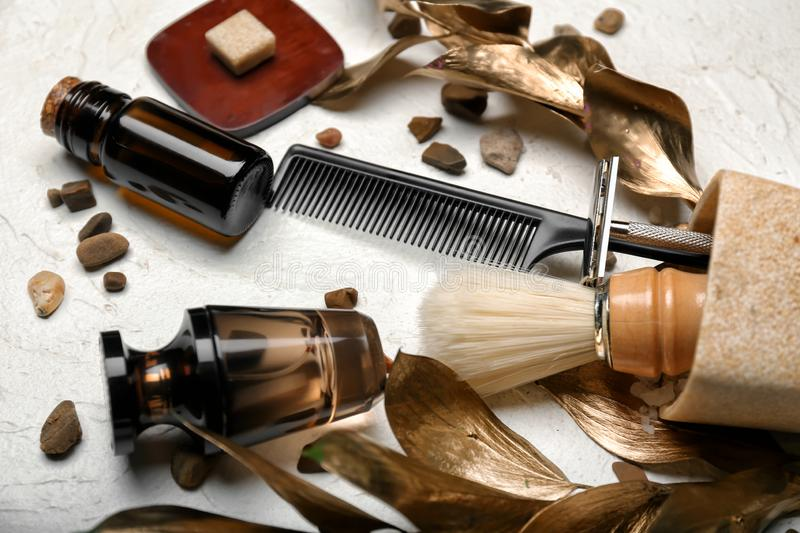 Composition with shaving accessories for men and cosmetics on white background stock photo