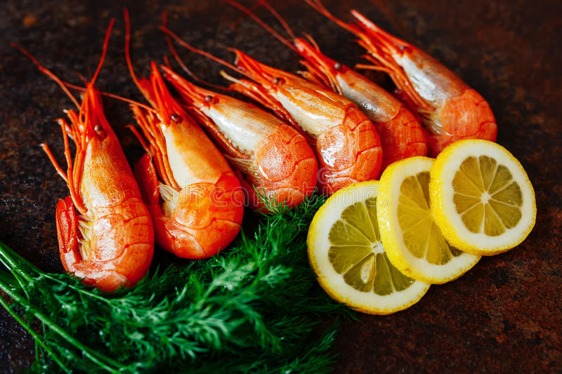 The composition of the shrimp and crab meat with lemon and herbs royalty free stock image