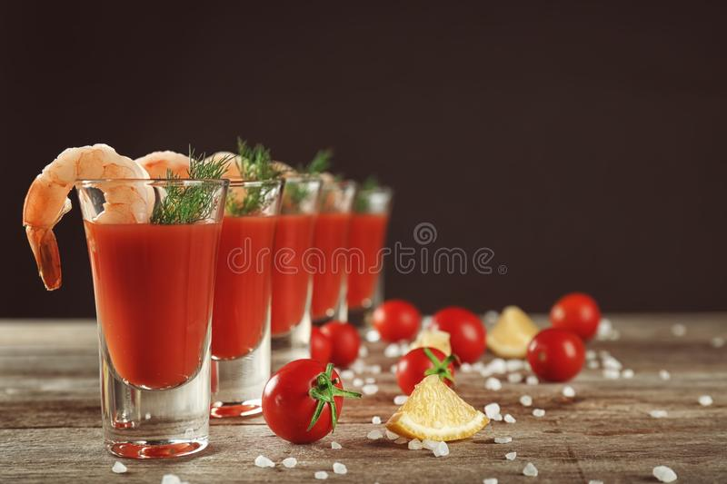 Composition with shrimps and tomato sauce in glasses royalty free stock photo