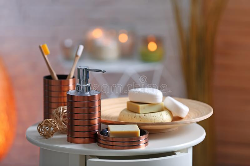 Composition with soap and toiletries on table against blurred background. Space for text royalty free stock photos