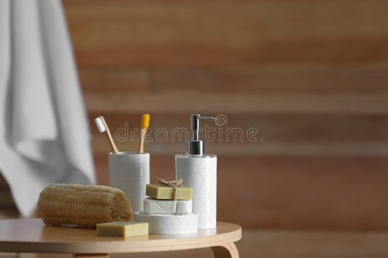 Composition with soap and toiletries on table against blurred background. Space for text royalty free stock images