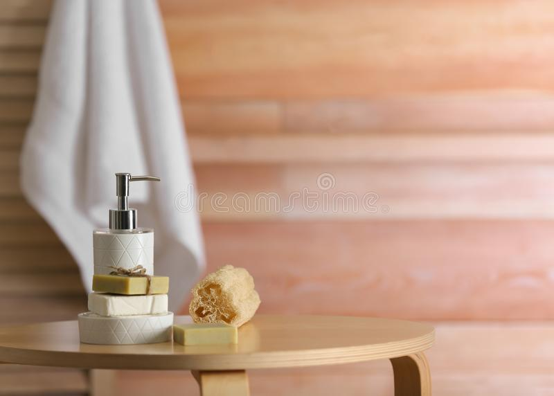 Composition with soap and toiletries on table against blurred background. Space for text stock image