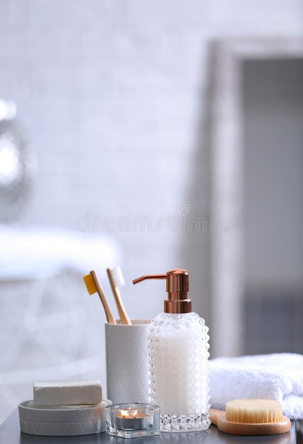 Composition with soap and toiletries on table against blurred background. Space for text stock photos
