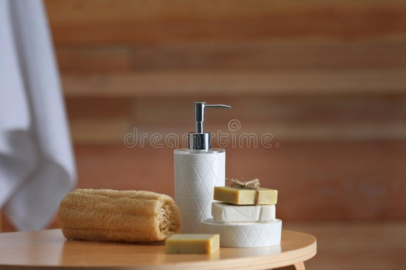 Composition with soap and toiletries on table against blurred background. Space for text royalty free stock photo