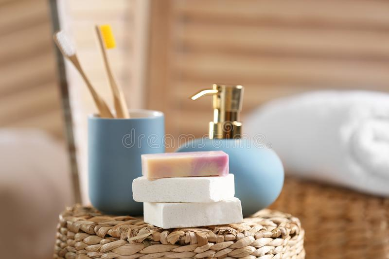 Composition with soap and toiletries on wicker basket. In bathroom stock image