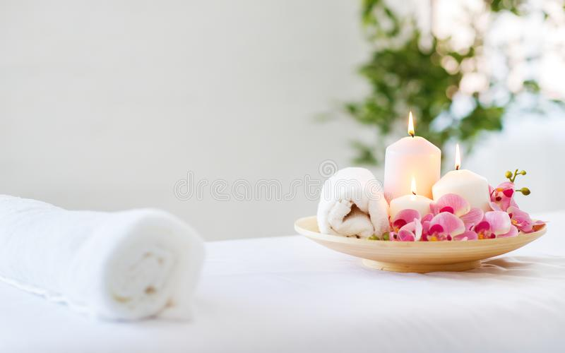 Composition of spa candles and towels stock photo