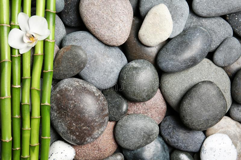 Composition with spa stones and bamboo branches as background stock images