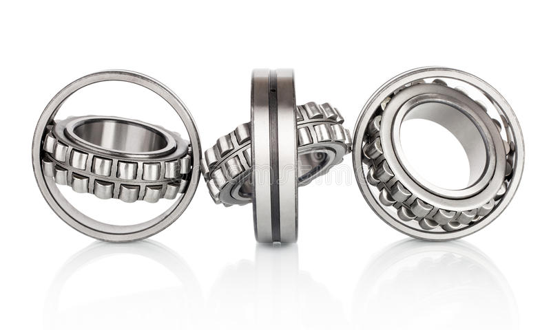 Composition of steel ball roller bearings in closeup isolated on white. Background royalty free stock image
