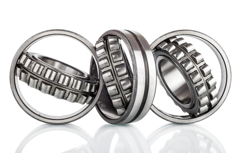 Composition of steel ball roller bearings in closeup on white. Background royalty free stock photography