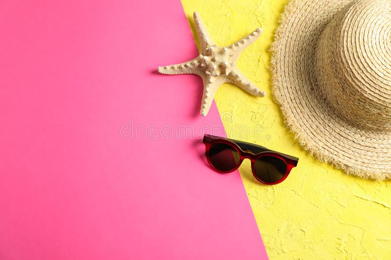 Composition with straw hat, sunglasses and starfish on two tone background. Space for text royalty free stock photos