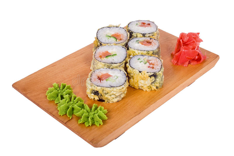 Composition of sushi in tempura on a wooden board stock photo