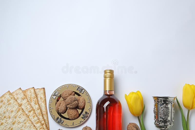 Composition with symbolic Passover Pesach items on white background, top view. Space for text stock photo