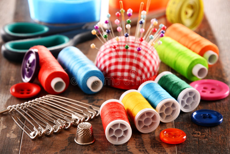 Composition with tailor accessories on wooden table.  stock image