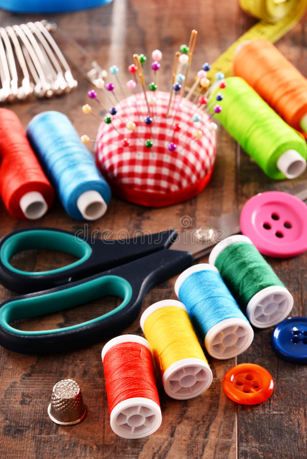 Composition with tailor accessories on wooden table.  stock photography