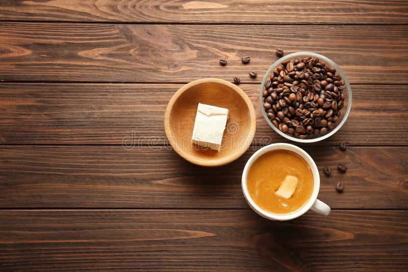 Composition with tasty butter coffee. On wooden table royalty free stock photography