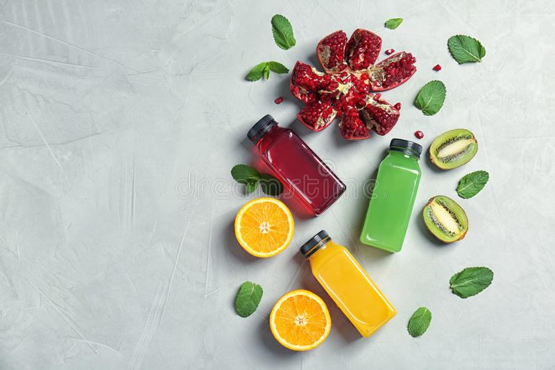 Composition with tasty juices and ingredients on light background, top view stock photography