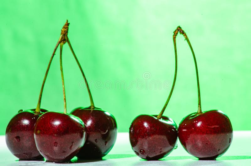 Composition of three and two ripe sweet cherries royalty free stock photos