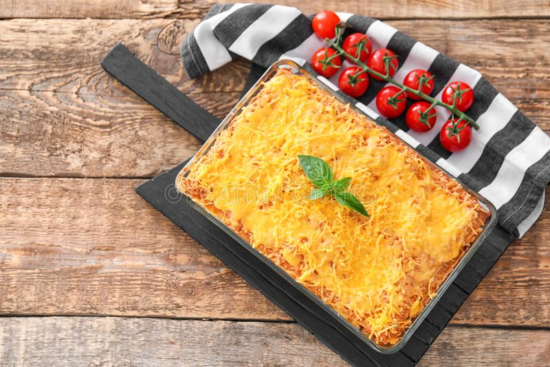 Composition of traditional meat lasagna and tomatoes royalty free stock images