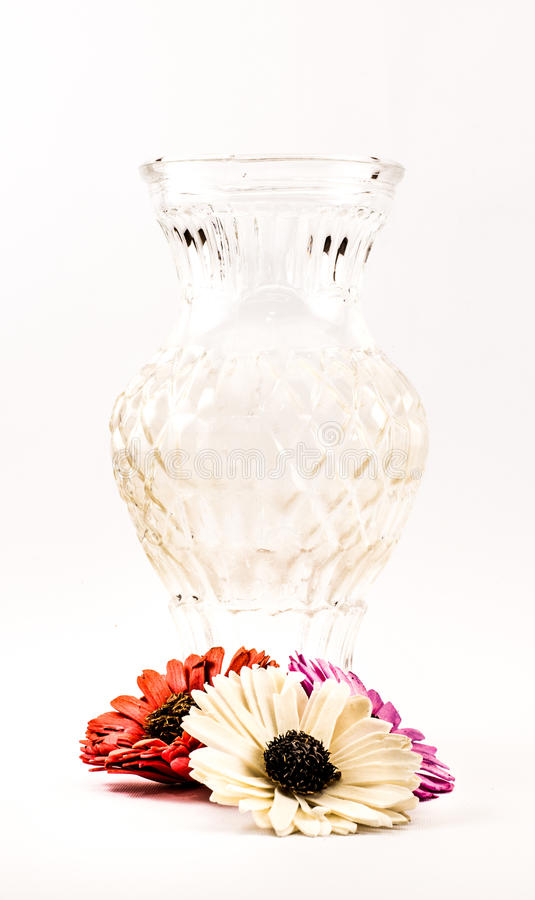 Composition of a transparent vase and flowers on a white background royalty free stock photo
