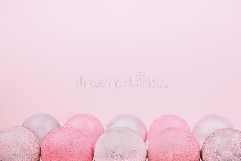 Composition of trendy coral and silver festive baubles on pastel background. Copy space. royalty free stock image