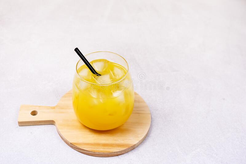 Composition With Two Glasses of Tasty Orange Juice Healthy VitaminBeverage with Ice Summer Drink Gray Background Horizontal Copy. Space stock image