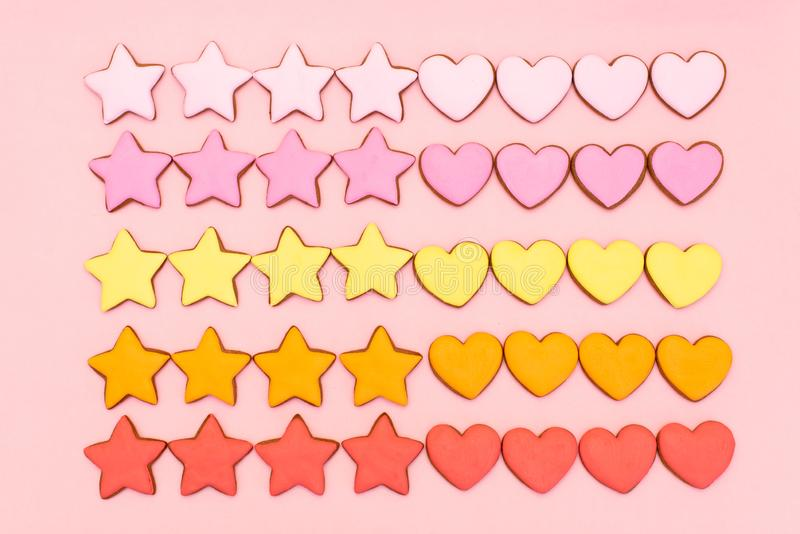 Composition Valentine`s Day. Ginger cookie in shape heart on pastel pink background. Valentine day concept, design royalty free stock image